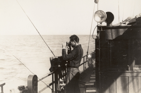 [Roger Revelle with sextant on R/V E.W. Scripps]