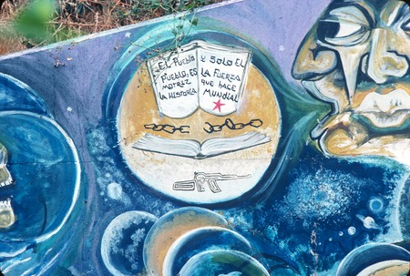 Chicano Park: Historical Mural: detail of an open book with inscription, broken chain and a gun