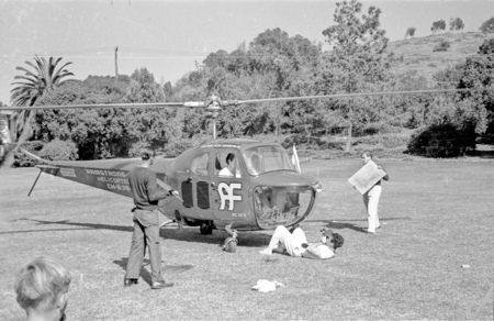 Actor Errol Flynn shown here arriving by helicopter at Scripps Institution of Oceanography. 1948.