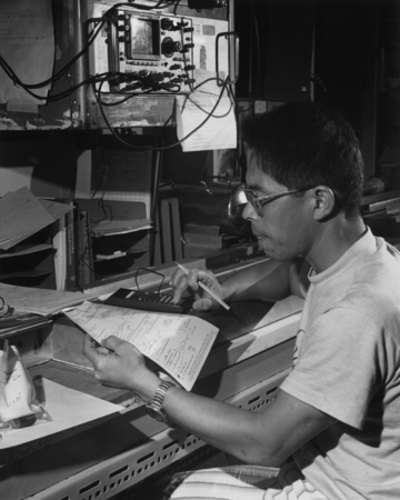 Paleo-Magnetism scientist Hajimu Kinoshita from Japan doing a calculation of sonic velocity data in the core laboratory on...