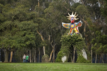 Sun God: general view of sculpture with vine covered arch and eucalyptus grove in background