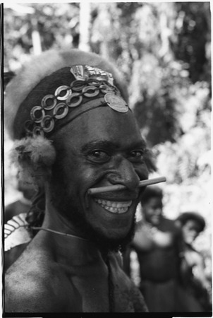 Gunts: smiling luluai (government appointed leader) with nose ornament, marsupial fur and shell-ring headdress
