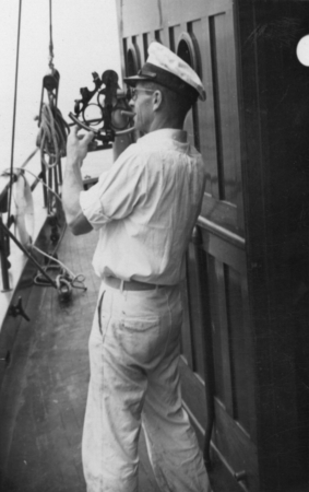 [Unidentified man shooting the sun with a sextant aboard R/V E.W. Scripps]