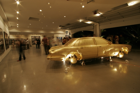 The Jewel / In God We Trust: junk car covered in gold leaf at the haudenschild Garage: auction night