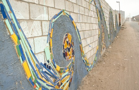 Popotla - The Wall: mosaic of found objects representing waves
