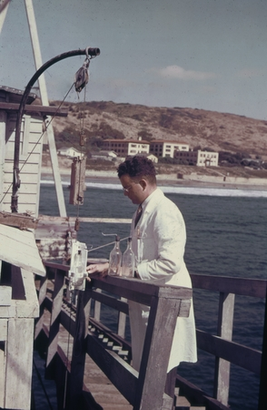Claude E. ZoBell, marine microbiologist, on the Scripps Institution of Oceanography pier