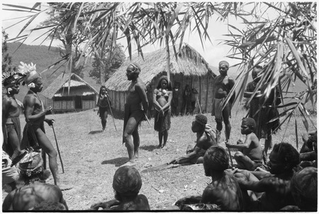 Dispute in Tuguma: disagreement between Mbi (right) over Krp's (left) shooting of pig