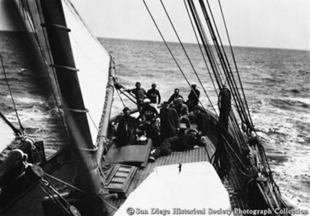 Crew of John D. Spreckels's yacht Lurline posing on deck while under sail