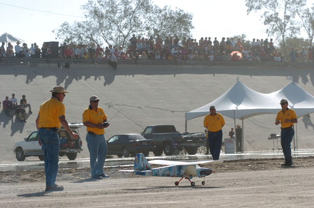 Aerial Bridge: model planes and pilots with spectators