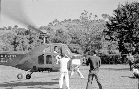 Actor Errol Flynn shown here arriving by helicopter at Scripps Institution of Oceanography
