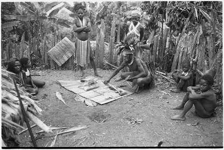 Pig festival, pig sacrifice, Tsembaga: ritual exchange of shell valuables, steel axes, and pork displayed on mat
