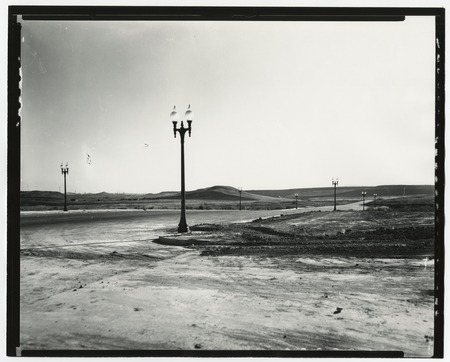 Graded roads and lamp posts in new subdivision, San Diego