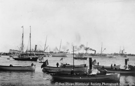 Great White Fleet launches moored on San Diego waterfront with other vessels in background