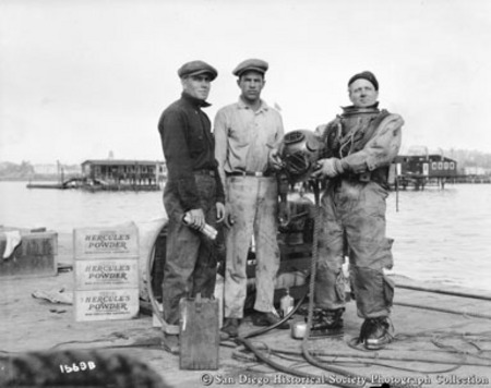 Hercules Powder Company kelp diver and two other men standing on dock