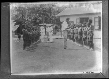 Men and children lined up for an assessment.