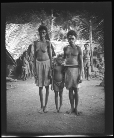 Woman, man, and child, probably in Vanuatu.