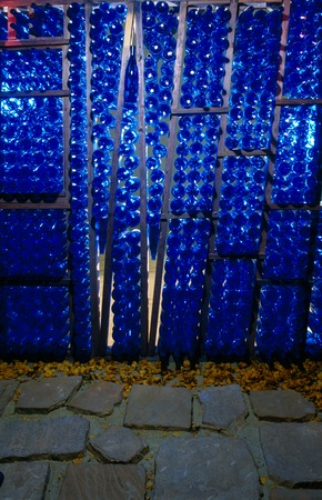 Abode: Sanctuary for the Familia(r): detail of blue glass bottles