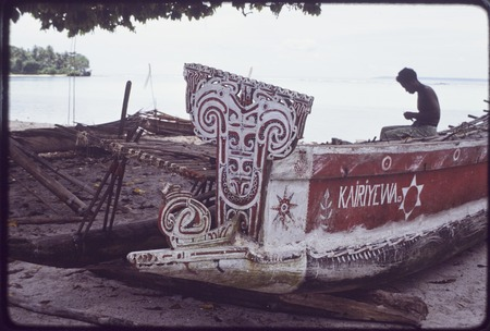 "Canoes: ""Kairiyewa"" written on the side of kula canoe, carved and painted elements on prow and sides"
