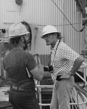 James L. Lawrence (left) converses with Albert Moldvay of the National Geographic Magazine aboard the D/V Glomar Challenge...