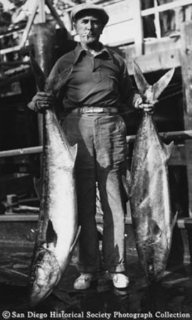 A.C. Line posing with catch of yellowtail tuna