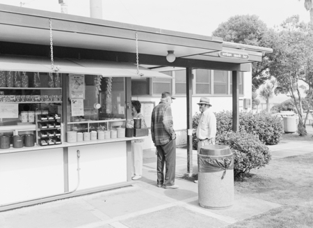 SIO Snack Bar 'Snackropolis' before remodel. Benjamin Volcani (on left) speaking with William J. Goff, SIO Library Directo...