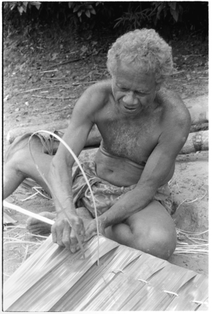 Geleniu sews palm leaf thatch panel