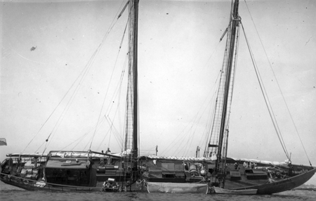 Research vessel E.W. Scripps (ship) stuck at low tide. The E.W. Scripps was a 100-foot sailboat with auxiliary power and t...