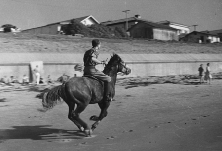 Man riding horse. University of California Division of War Research beach picnic, near SIO, 1942