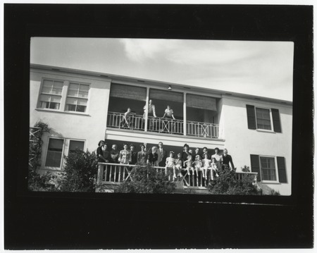 Fletcher family portrait, posing on home balconies