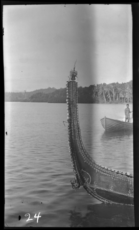 Solomon Island decorated canoe point, sculpted head close to waterline.