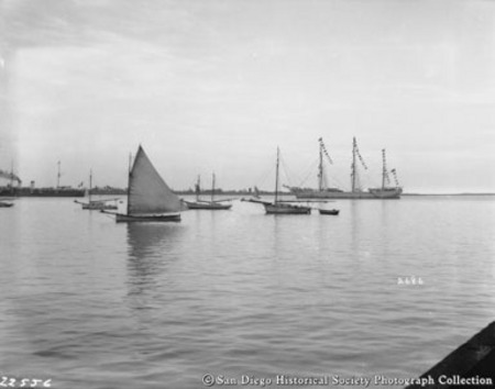 Ship and small boats on San Diego Bay