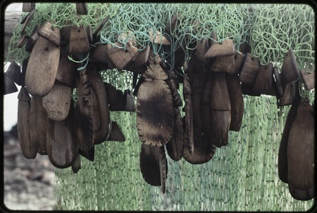 Fishing: nets with hand-carved wooden floats, some shaped like leaves or small fish