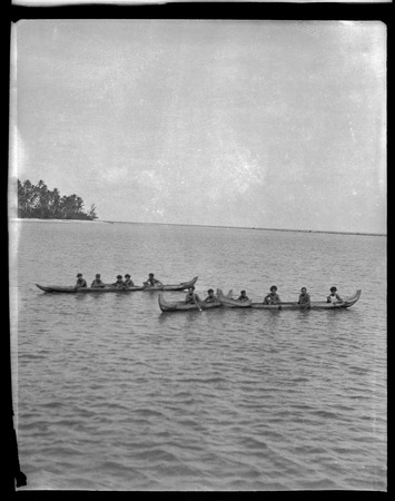 Several men on canoes.