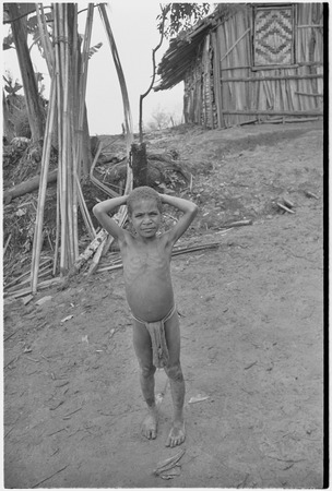Child in front of Rappaport's house in Tsembaga