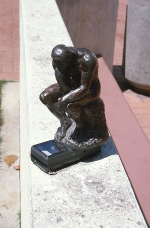 "Something Pacific: detail: bronze figurine of Rodin's ""The Thinker"" on top of miniature portable television"