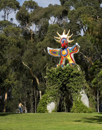 Sun God: general view of sculpture with arch and vines