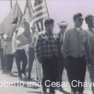 ROBERTO  BUSTOS AND CESAR CHAVEZ IN 1966 ON OUR WAY TO SACRAMENTO ALONG WITH MARCHERS LUIS VALENZUELA AND PETE CARDENAS.