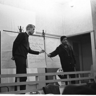 LeRoy Chatfield & Cesar Chavez take turns explaining the UFW\'s Robert F. Kennedy Medical Plan at a union membership meeting./ Photo by Nick Jones
