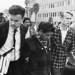 Jerry Cohen & LeRoy Chatfield escort Cesar Chavez from the Kern County Courthouse after Cesar\'s court hearing was postponed.